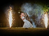 crazy-bear-wedding-couple-with-gold-fountain-fireworks.jpg